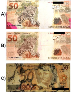 Fig. 1. A picture of one banknote each from the three sets of true forensic samples of seized banknotes with different ATD contamination: A) banknote recognized to be from an exploded ATM, presenting apparent ATD dye on the surface; B) banknote suspected to be from an ATM explosion followed by ATD impregnation, presenting characteristics of an attempted cleanup procedure with the use of organic solvents; C) banknote impregnated with a dark substance probably due to an attempt at cleanup using oxidative methods and/or high temperatures.