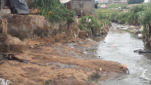 Sewage drains from pit latrines directly into the Motoine River in Kibera, Kenya. Photo: Nicholas Kiulia.
