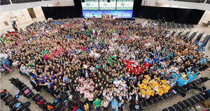 The image shows the attendees at the iGEM 2015 Jamboree. Used with permission from the iGEM Foundation