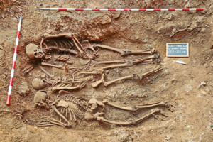 Fig. 1. The Second World War mass grave Kržeti from Slovenia with three excavated skeletons (photo Marko Pečovnik).