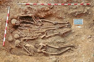 Fig. 1. The Second World War mass grave Kržeti from Slovenia with three excavated skeletons (photo Marko Pečovnik).