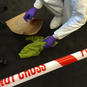 Fig. 1. A crime scene investigator retrieving a jumper from the crime scene; but can forensic scientists reliably interpret the DNA recovered from it?